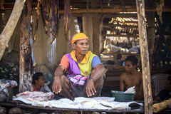 Indonesian fisherman selling fish. Royalty Free Stock Photography