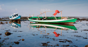 Indonesian Fishing Boats. Old wooden fishing boats in Indonesia Royalty Free Stock Photos
