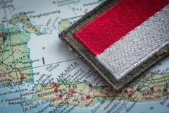 Indonesian flag on the background of the indonesia map. View of the Indonesian flag on the background of the Indonesia map royalty free stock photo