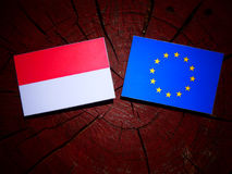 Indonesian flag with EU flag on a tree stump isolated Stock Images