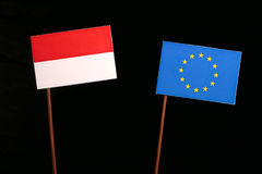 Indonesian flag with European Union EU flag  on black. Background Royalty Free Stock Photography