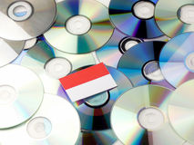 Indonesian flag on top of CD and DVD pile isolated on white. Indonesian flag on top of CD and DVD pile isolated Stock Photography