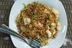 Indonesian food, mie goreng ayam, fried noodles with chicken. Bali, Indonesia. Stock Image