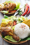 Indonesian food nasi ayam penyet. Famous traditional Malay food. Delicious nasi ayam penyet with sambal belacan. Local flavor. Fresh hot with steam smoke stock photography