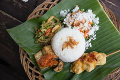 Indonesian food and satay served using banana leaf Royalty Free Stock Photo