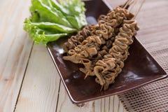 Sate usus. indonesian food. Indonesian food. sate usus in close up portrait. intestines satay stock image