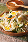 Indonesian gado-gado salad close-up on a plate. vertical Stock Image