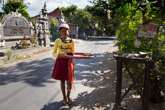 Indonesian girl bring offerings to the home temple Royalty Free Stock Photos