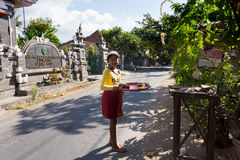 Indonesian girl bring offerings to the home temple Royalty Free Stock Image