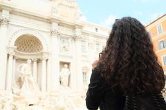Girl taking photos of Fontana di Trevi Stock Photos