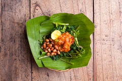 Indonesian green salad. From above. Indonesian green salad with fryied penuts spicy and lime in a basket Stock Images