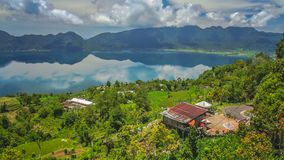 Indonesian home above Lake Maninjao royalty free stock image