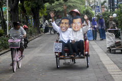 INDONESIAN JOKOWI MARITIME ORIENTED POLICY. Supporters wear masks of Indonesian President Joko Widodo, nicknamed Jokowi, at Solo, Java, Indonesia. Since taking royalty free stock images