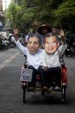 INDONESIAN JOKOWI MARITIME ORIENTED POLICY. Supporters wear masks of Indonesian President Joko Widodo, nicknamed Jokowi, at Solo, Java, Indonesia. Since taking stock photo