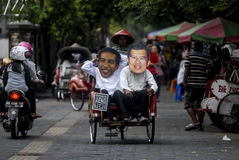 INDONESIAN JOKOWI MARITIME ORIENTED POLICY. Supporters wear masks of Indonesian President Joko Widodo, nicknamed Jokowi, at Solo, Java, Indonesia. Since taking royalty free stock photography