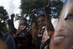 INDONESIAN JOKOWI MARITIME ORIENTED POLICY. Supporters wear masks of Indonesian President Joko Widodo, nicknamed Jokowi, at Solo, Java, Indonesia. Since taking royalty free stock image