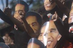 INDONESIAN JOKOWI MARITIME ORIENTED POLICY. Supporters wear masks of Indonesian President Joko Widodo, nicknamed Jokowi, at Solo, Java, Indonesia. Since taking stock photos