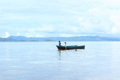 Indonesian kids playing in sea Royalty Free Stock Images