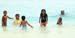 Indonesian kids playing in sea Royalty Free Stock Photo