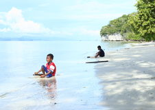 Indonesian kids playing in sea Stock Photography