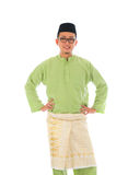 Indonesian male during ramadan festival with isolated white back. Ground Royalty Free Stock Photo