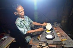 Indonesian Man Making Traditional Cake Soerabi. Man preparing indonesian traditional salted cake soerabi in Majalengka, West Java, Indonesia Royalty Free Stock Photos