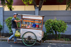 Indonesian man sells local fast food Royalty Free Stock Photography