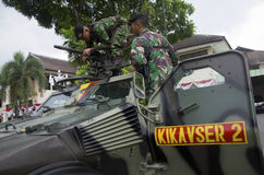 INDONESIAN MILITARY TO FIGHT ISLAMIC STATE EXTERNAL THREATS. Members of the 2nd Assault Cavalry Company of Indonesian Army are checking their equipment in Solo Royalty Free Stock Image