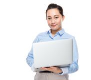 Indonesian mixed race business woman hold laptop computer Stock Images