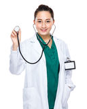 Indonesian mixed race woman doctor hold stethoscope Stock Images