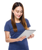 Indonesian mixed race woman look at digital tablet Royalty Free Stock Photos