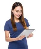 Indonesian mixed race woman look at digital tablet Royalty Free Stock Photos