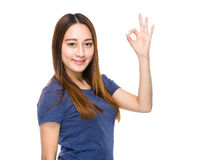 Indonesian mixed race woman with ok sign Royalty Free Stock Images