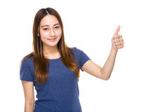 Indonesian mixed race woman with thumb up Royalty Free Stock Photography
