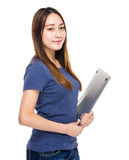 Indonesian mixed race young woman hold notebook computer Royalty Free Stock Images
