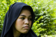 Indonesian moslim girl. In a black scarf Stock Images