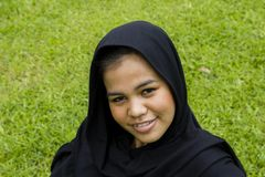 Indonesian moslim girl. In a black scarf Stock Image