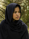 Indonesian moslim girl. In a black scarf Royalty Free Stock Photography