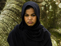 Indonesian moslim girl. In a black scarf Royalty Free Stock Image