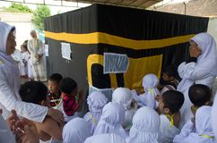 INDONESIAN MUSLIM CHILDREN HAJJ PILGRIMAGE TRAINING Royalty Free Stock Photo