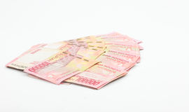 Indonesian notes on white background Stock Images
