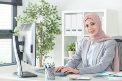Indonesian office lady typing e-mail