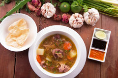 Indonesian Oxtail Soup or Sop Buntut. With ingredient stock photography