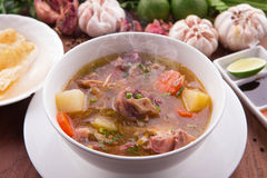 Indonesian Oxtail Soup or Sop Buntut. On wood base stock photography