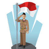 Indonesian Patriot. Giving Salute to His Mother National Indonesia Flag Stock Image