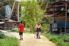 Indonesian people on the road in Lempo village. Tana Toraja Stock Photo
