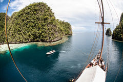 Indonesian Pinisi Schooner in Tropical Bay Stock Photos
