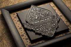 Indonesian plaque featuring pohon beringin puppet Royalty Free Stock Photography