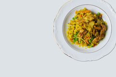 Indonesian. Plate with nasi goreng against white background Stock Photo