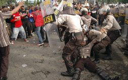 INDONESIAN POLICE CONTROVERSY. A riot handling simulation held by the Indonesian Police in Solo, Java, Indonesia. Indonesian Police are controversially on Stock Image
